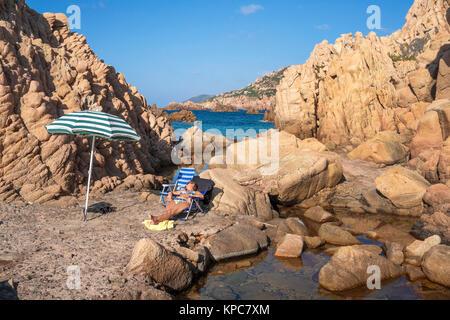 Idyllic bathing beach at rocky coast of Costa Paradiso, Porphyry rocks, Sardinia, Italy, Mediterranean  sea, Europe - Stock Photo