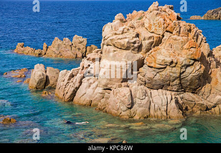Snorkeler at porphyry rocks, Costa Paradiso, Sardinia, Italy, Mediterranean  sea, Europe - Stock Photo