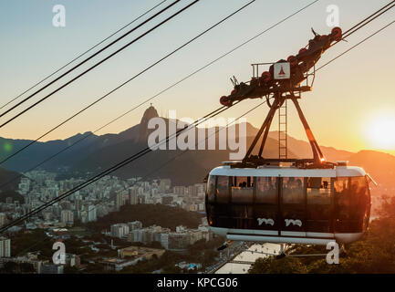 Cable Car to Morro da Urca and Sugarloaf Mountain at sunset, Rio de Janeiro, Brazil - Stock Photo