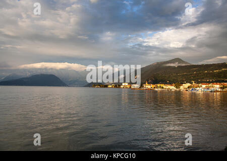 Lake Iseo, Italy. Picturesque dusk view of Lake Iseo, with the town of Iseo on the right of the image and the island - Stock Photo