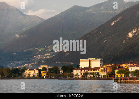 Lake Iseo, Italy. Picturesque dusk view of Lake Iseo, and the town of Iseo. The scene was captured looking eastwards - Stock Photo