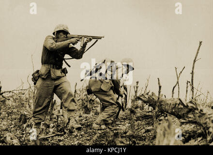 Two Marines from the 2nd Battalion, 1st Marine Regiment during fighting at Wana Ridge during the Battle of Okinawa, - Stock Photo