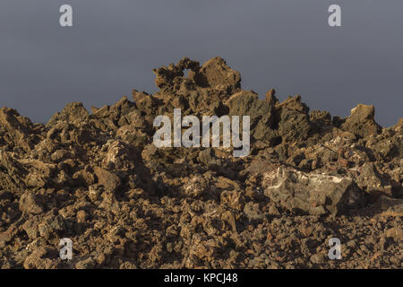 Volcanic rock from lava flow macro. Lava field in Timanfaya National Park in Lanzarote, Canary Islands, Spain. - Stock Photo