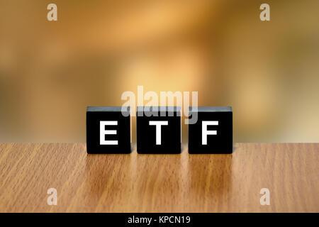 ETF or exchange traded fund on black block - Stock Photo