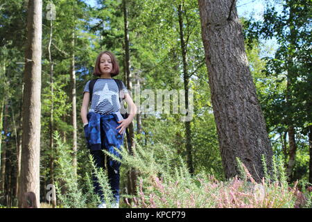 young girl in woods - Stock Photo