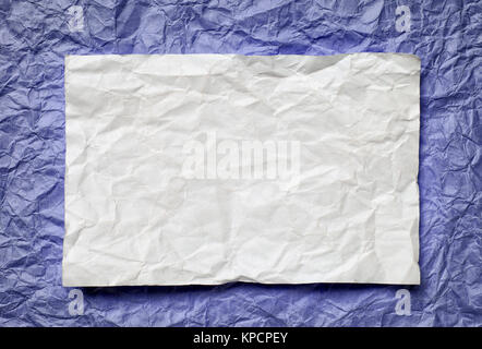 paper card on violet background - Stock Photo