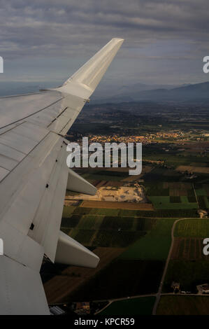 Taking off Aerial View on Verona from Aircraft Porthole - Stock Photo