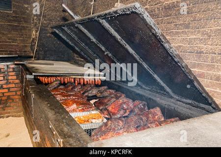 Texas, Caldwell County, Lockhart, Smitty's Market, barbecue restaurant, smoker - Stock Photo