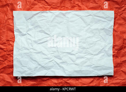 paper card on red background - Stock Photo