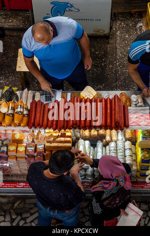 A Man Sells Meat Products From A Stall In Chorsu Bazaar, Tashkent, Uzbekistan - Stock Photo