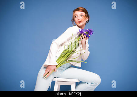 beautiful woman with iris flowers - Stock Photo