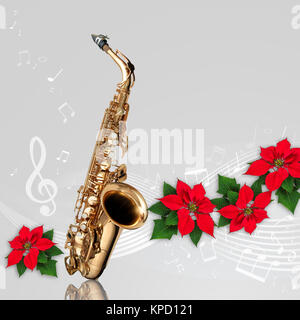 Saxophone with musical notes and Red Poinsettia flower christmas ornament on gray background - Stock Photo