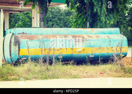 Old  grunge  fuel and oil tank - Stock Photo