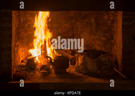 Fire fireplace traditional kettle winter time - Stock Photo