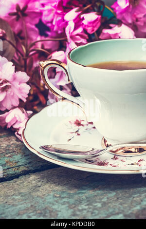 Beautiful, English, vintage teacup with Japanese cherry tree blossoms, close upt - Stock Photo