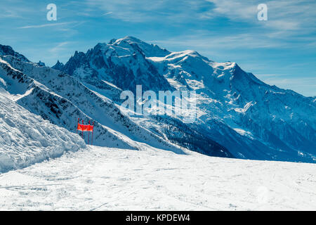 Mont Blanc in winter  viewed from a ski slope in the ski resort of Le Tour near Chamonix  the French Alps. The piste - Stock Photo