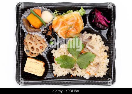 Japanese bento lunch isolated on white background - Stock Photo