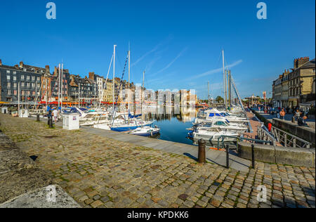 The old pier at the picturesque French village on the coast of Normandy at the English Channel, Honfleur, on a sunny - Stock Photo