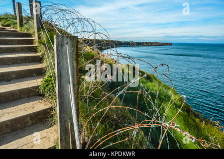 The coast of Normandy France, Pointe du hoc where the allied forces faced the Germans during World War 2, with barbed - Stock Photo