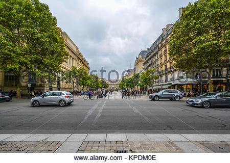 A street scene on the Ile de la Cite in the fourth arrondisement with the Palais du Justice visible on the right - Stock Photo