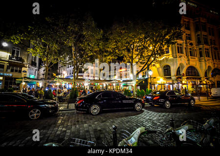 A colorful and lively cafe in the 4th arrondissement near Boulevard Saint-Michel in the late evening - Stock Photo