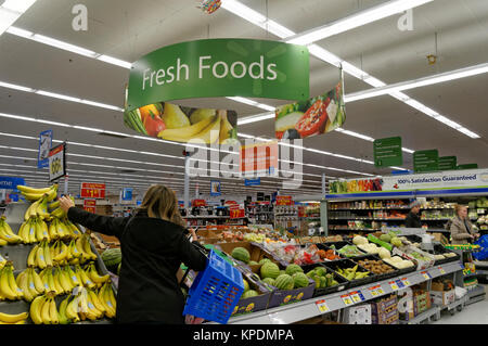 Woman shopping in the produce department of a Walmart store, North Vancouver, BC, Canada - Stock Photo