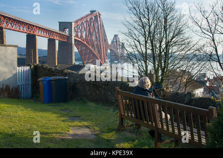 Sitting by the Forth Rail Bridge - Stock Photo