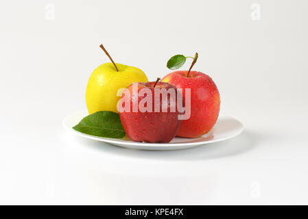 three apples on plate - Stock Photo