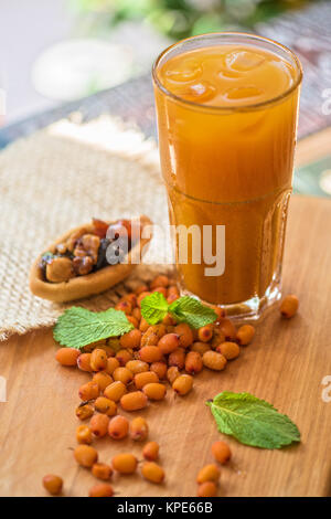 fruit drink with sea buckthorn - Stock Photo