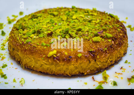 turkish dessert kunefe isolated with pistachio clipping path inside - Stock Photo