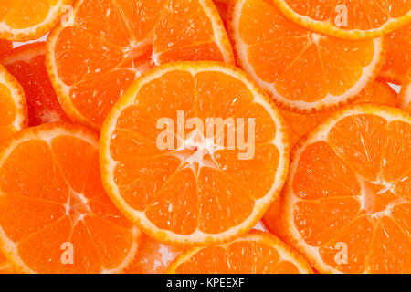 background of slices of clementine fruit - Stock Photo