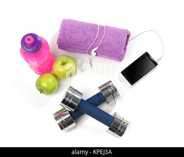 Fitness concept with a bottle of water, a towel, dumbbells, apples and a smartphone - Stock Photo