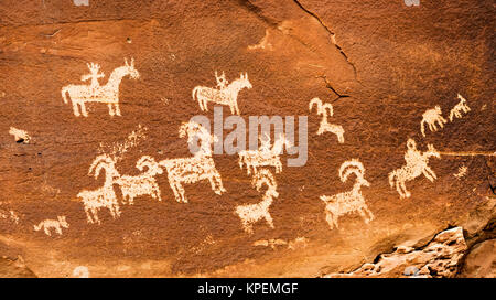Petroglyphs or rock carvings in Arches National Park, Utah, USA - Stock Photo
