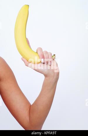 Banane als Waffe, Waffen der Frau - woman with banana - Stock Photo
