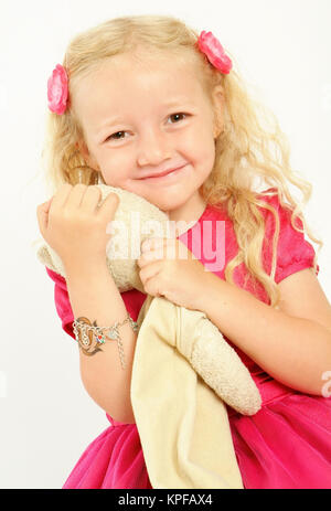 Maedchen, 5 Jahre, mit Stofftier - girl, 5 years old, with toy - Stock Photo