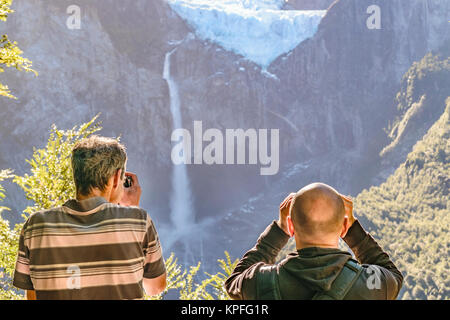 Men taking photos of glacier at queulat park, patagonia, chile - Stock Photo