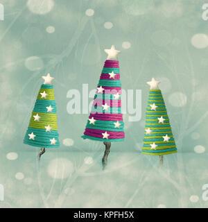 Three beautiful colorful cones shape Christmas trees - Stock Photo