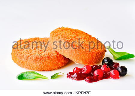 Fried camembert with berry garnish - Stock Photo