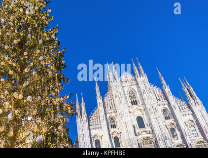Christmas and New Year tree at the central square in front of Milan Duomo. Italy - Stock Photo