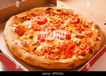 Vegetarian fast food. Margaretha or margarita margherita pizza texture in pizza box. Pizza without meat. Tasty delicious - Stock Photo