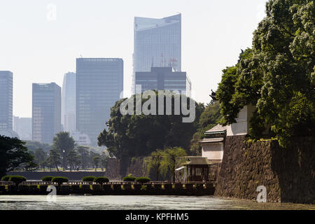 Tokyo skyscrapers seen behind the Imperial Palace walls and Palace moat in central Tokyo, Japan. Friday October - Stock Photo