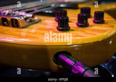 connects the guitar; close up selective focus - Stock Photo