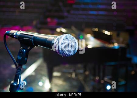 recording microphone above grand piano - Stock Photo