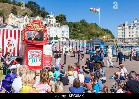 punch and judy llandudno north wales kids watching a traditional punch and judy show with puppets on the promenade - Stock Photo