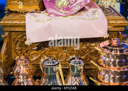 typical vintage virgin teapots and wooden chest - Stock Photo