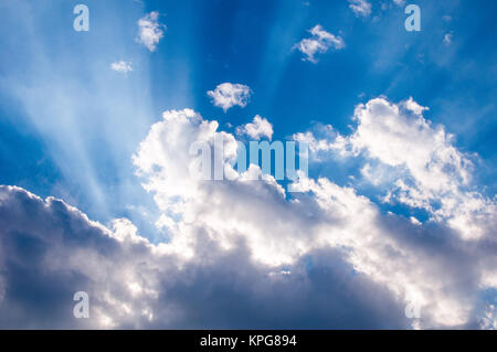 heavenly sunrays through clouds - Stock Photo