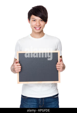 Young man showing with chalkboard - Stock Photo