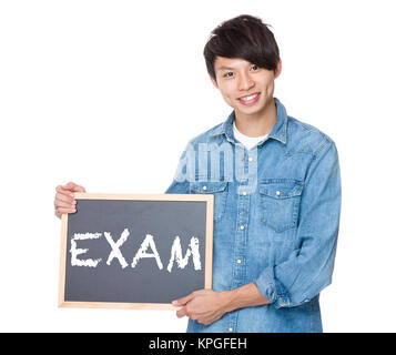 Man hold with blackboard showing a word exam - Stock Photo