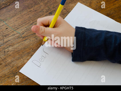 Child writing a letter - Stock Photo