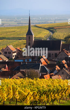 France, Bas-Rhin, Alsace Region, Alsatian Wine Route, Blienschwiller, town overview from vineyards, autumn - Stock Photo